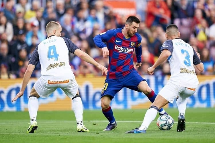 Lionel Messi of FC Barcelona Takes on Two Players in a Match contested in the Spanish La Liga.