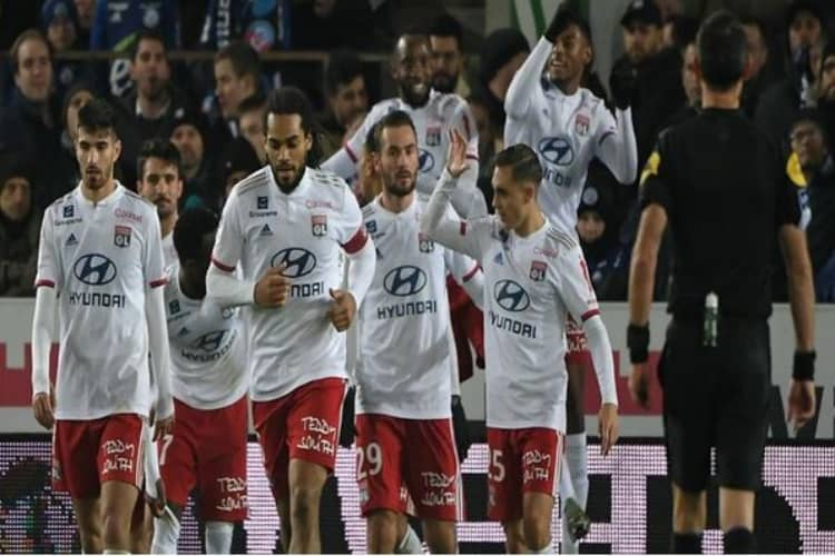 Lyon Players Celebrate Scoring a Goal in a Match Contested in the French Ligue 1