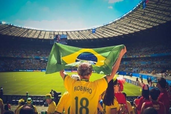 A Brazilian Football Fan Is Wearing a Jersey with Robinho's Name on It
