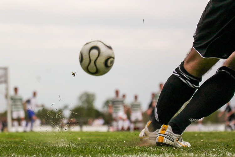 A football being kicked