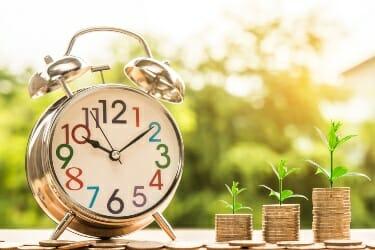 Clock next to money