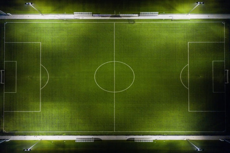 Aerial View of a Football Field under Floodlights