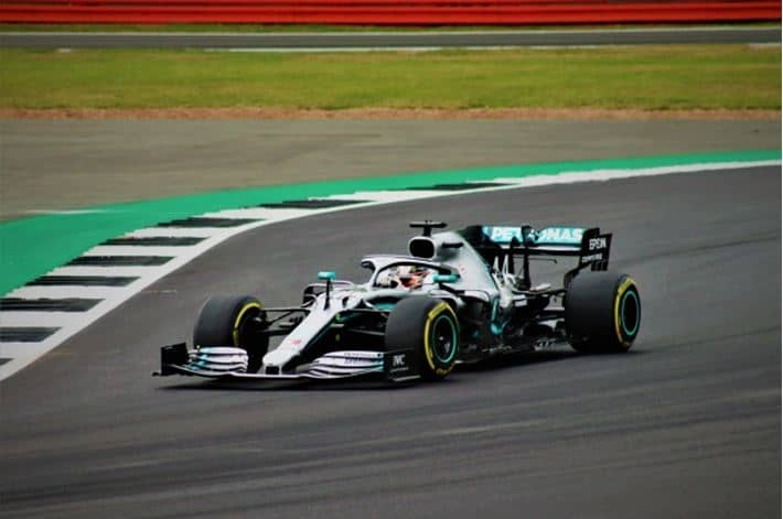 Lewis Hamilton drives a go-kart in race