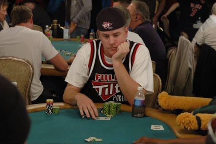 professional poker player Erick Lindgren sits at table