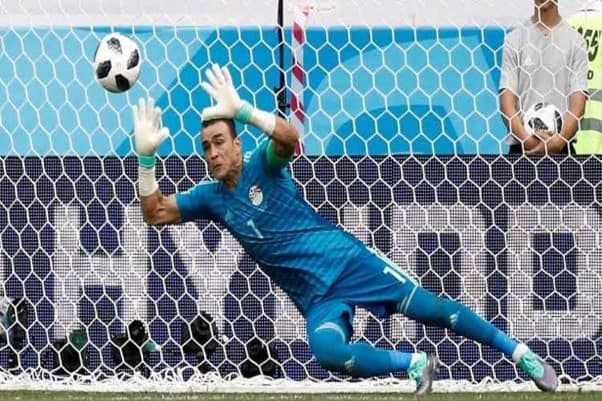 Egypt's 45 Year Old Goalkeeper, Essam El Hadary, Saves a Goal Bound Shot during a Match in the 2018 FIFA World Cup. Clean sheets team goals.