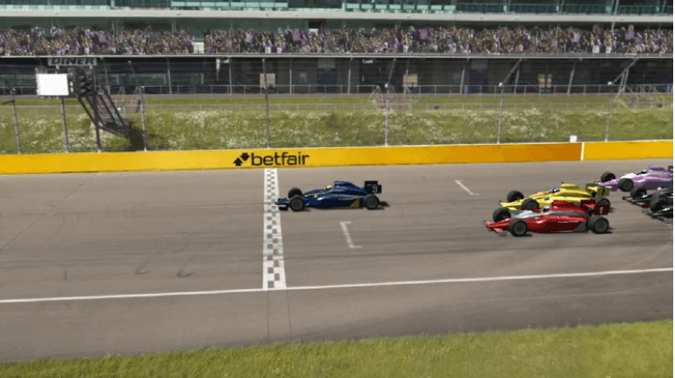 virtual motor race underway on a racing circuit with betfair banner in background