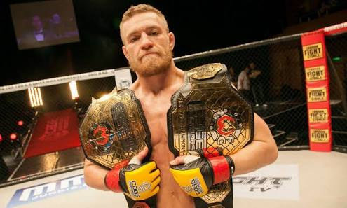 Connor McGregor Double Champ in Cage Warriors