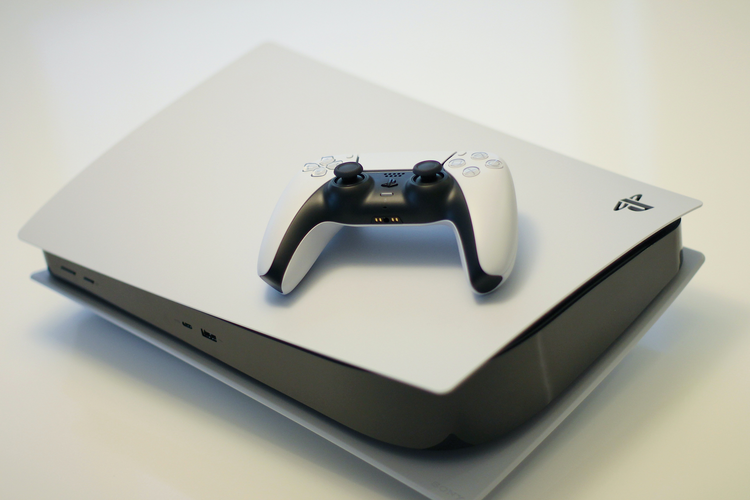 Playstation 5 console with controller on top