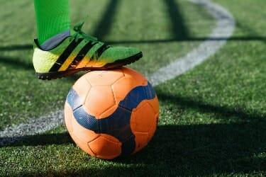 Football ball on pitch