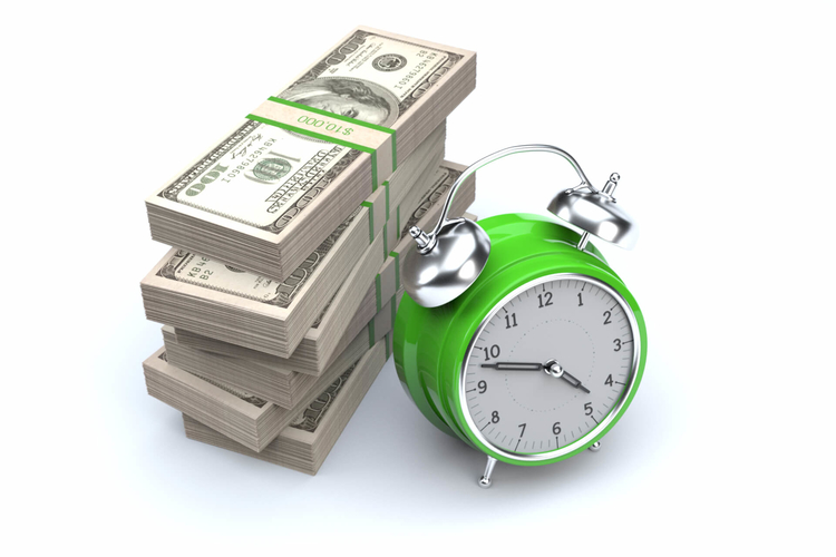 Photo of a clock and a stack of money