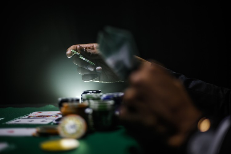 Image of a person gambling