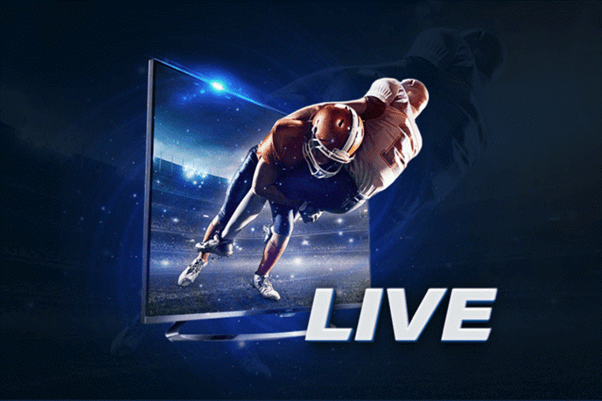 1xbet live ad - A photo manipulation of two American football players coming out of a TV screen