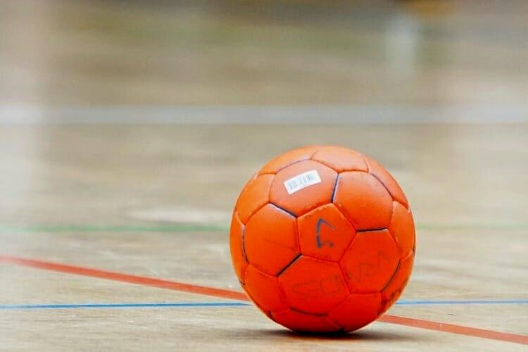 An image of a handball ball on the floor